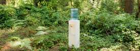 A water cooler in the middle of a forest