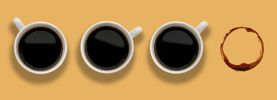 Three coffee cups, with a fourth missing
